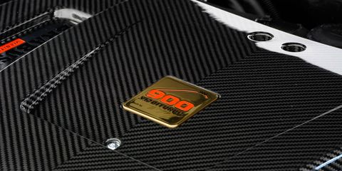 Logo, Guitar amplifier, Symbol, Brand, Trademark, Label, Carbon, Electronic instrument, Emblem, Mesh,