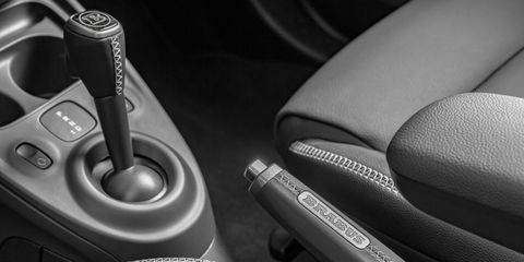 Automotive design, Gear shift, Photography, Steering part, Steering wheel, Luxury vehicle, Center console, Personal luxury car, Car seat, Leather,