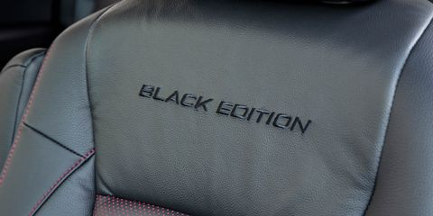 Car seat, Head restraint, Car seat cover, Leather, Seat belt, Carbon, Silver, Armrest,