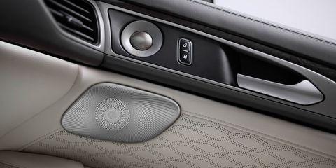 Automotive design, Automotive exterior, Fixture, Grey, Luxury vehicle, Metal, Vehicle door, Carbon, Personal luxury car, Silver,