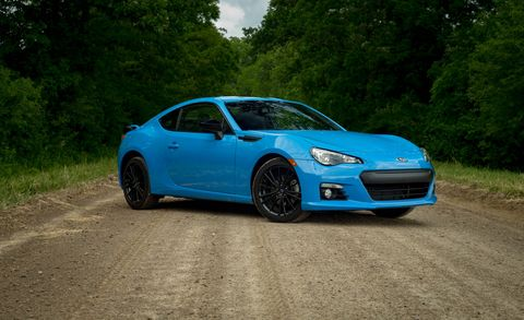 Tire, Automotive design, Blue, Vehicle, Rim, Hood, Alloy wheel, Performance car, Car, Automotive lighting,