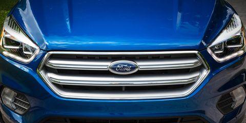 Motor vehicle, Automotive design, Blue, Mode of transport, Daytime, Automotive exterior, Grille, Car, Headlamp, Mercedes-benz,