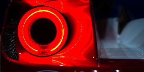 Automotive lighting, Red, Automotive tail & brake light, Amber, Logo, Light, Carmine, Automotive light bulb, Brand, Symbol,