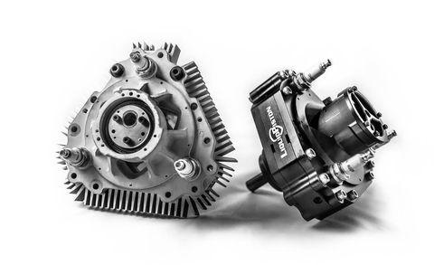Product, Gear, Font, Machine, Clutch part, Black-and-white, Automotive engine timing part, Automotive engine part, Metal, Circle,