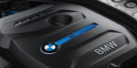 Automotive design, Logo, Luxury vehicle, Grey, Personal luxury car, Machine, Electric blue, Carbon, Sports car, Hybrid vehicle,