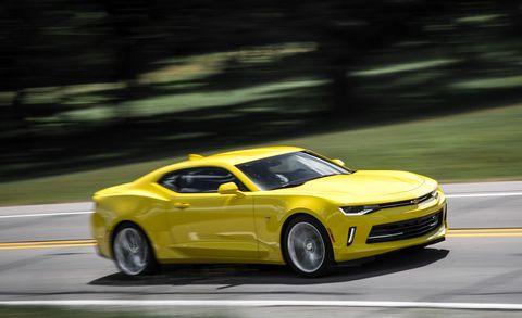 Tire, Wheel, Automotive design, Vehicle, Yellow, Road, Chevrolet camaro, Infrastructure, Performance car, Automotive tire,