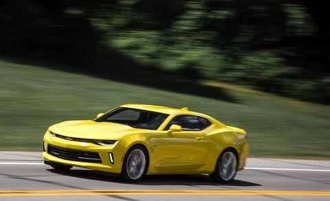 Tire, Wheel, Automotive design, Vehicle, Yellow, Road, Car, Chevrolet camaro, Hood, Automotive lighting,