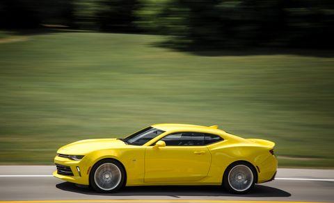 Tire, Wheel, Automotive design, Yellow, Vehicle, Automotive tire, Rim, Performance car, Car, Hood,