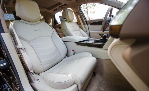 Motor vehicle, Mode of transport, Car seat, Vehicle door, Car seat cover, Head restraint, Seat belt, Luxury vehicle, Automotive window part, Family car,