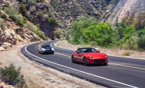 Road, Automotive design, Mode of transport, Vehicle, Infrastructure, Car, Performance car, Rim, Automotive lighting, Road surface,