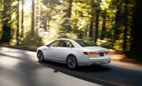 Tire, Wheel, Motor vehicle, Mode of transport, Automotive design, Road, Automotive mirror, Vehicle, Automotive lighting, Transport,