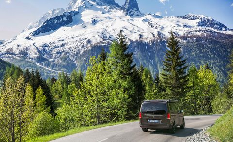 Motor vehicle, Mountainous landforms, Road, Automotive tail & brake light, Automotive mirror, Mountain range, Automotive exterior, Automotive lighting, Automotive parking light, Road surface,
