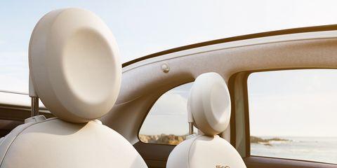 Mode of transport, Daytime, White, Beige, Vehicle door, Windshield, Automotive window part, Automotive side-view mirror, Automotive mirror, Steering wheel,