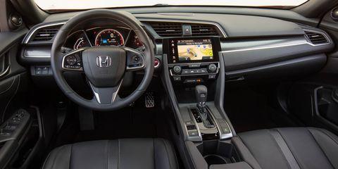 Motor vehicle, Steering part, Automotive design, Steering wheel, Product, Center console, White, Technology, Automotive mirror, Vehicle audio,