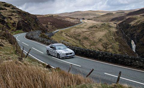 Road, Mountainous landforms, Automotive design, Land vehicle, Infrastructure, Car, Rim, Highland, Automotive exterior, Hill,