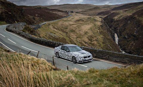 Road, Automotive design, Rim, Alloy wheel, Mountainous landforms, Car, Automotive mirror, Fender, Spoke, Highland,