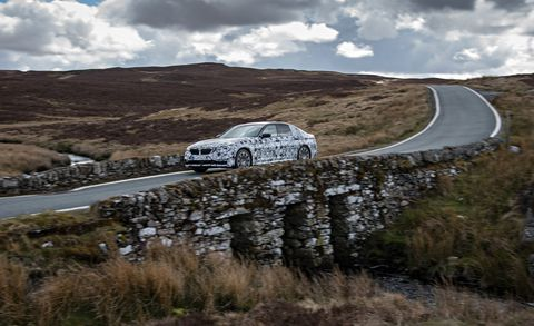Road, Mountainous landforms, Car, Alloy wheel, Highland, Fender, Automotive exterior, Rim, Performance car, Luxury vehicle,