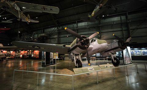 Airplane, Aircraft, Propeller-driven aircraft, Hangar, Aerospace engineering, Propeller, Aviation, Glass, Iron, Military aircraft,