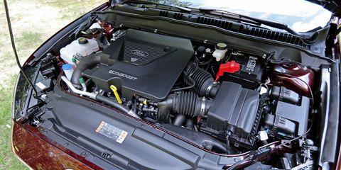 Engine, Automotive engine part, Automotive air manifold, Automotive super charger part, Personal luxury car, Hood, Luxury vehicle, Fuel line, Kit car, Nut,