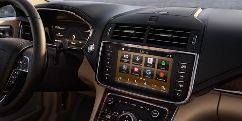 Motor vehicle, Steering part, Automotive design, Brown, Product, Steering wheel, Electronic device, Vehicle audio, Center console, Technology,