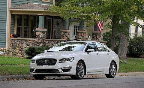 Tire, Automotive design, Flag, Window, Vehicle, Grille, Rim, Alloy wheel, Car, Personal luxury car,