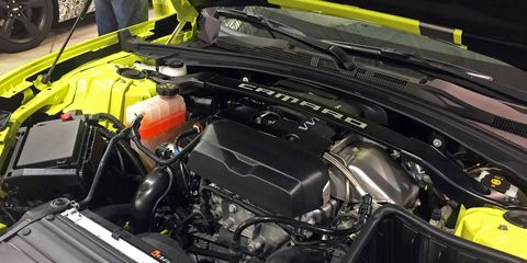 Motor vehicle, Automotive design, Engine, Automotive engine part, Personal luxury car, Hood, Automotive super charger part, Luxury vehicle, Automotive air manifold, Fuel line,