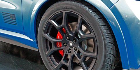 Tire, Wheel, Automotive tire, Automotive design, Blue, Alloy wheel, Automotive wheel system, Vehicle, Automotive exterior, Rim,