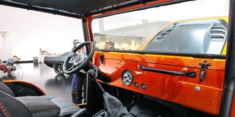 Motor vehicle, Mode of transport, Automotive design, Vehicle, Automotive exterior, Steering wheel, Steering part, Fender, Glass, Vehicle door,