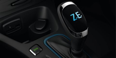 Motor vehicle, Automotive design, Logo, Gear shift, Luxury vehicle, Carbon, Center console, Personal luxury car, Steering part, Personal computer hardware,