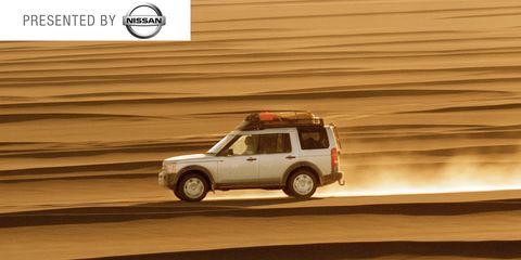 Automotive design, Natural environment, Automotive tire, Land vehicle, Automotive exterior, Sand, Automotive carrying rack, Landscape, Car, Aeolian landform,