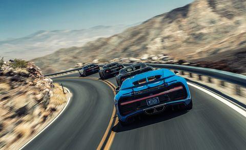Road, Mode of transport, Automotive design, Mountainous landforms, Vehicle, Automotive mirror, Infrastructure, Automotive lighting, Automotive exterior, Car,