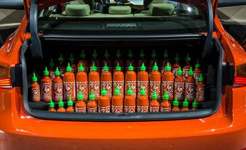 Orange, Bottle, Logo, Machine, Bumper, Brand, Label, Number, Office equipment, Bottle cap,