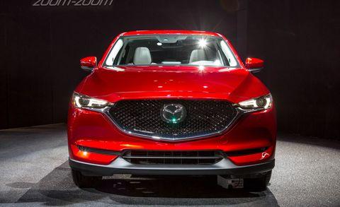 Automotive design, Mode of transport, Product, Vehicle, Event, Automotive lighting, Car, Grille, Red, Headlamp,