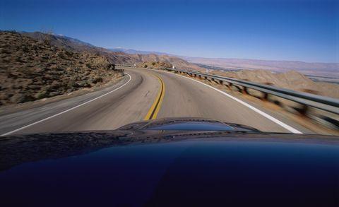 Motor vehicle, Road, Mountainous landforms, Road surface, Infrastructure, Asphalt, Highway, Landscape, Horizon, Automotive exterior,