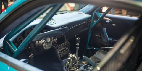 Motor vehicle, Steering part, Steering wheel, Vehicle door, Teal, Windshield, Automotive window part, Classic car, Gauge, Speedometer,