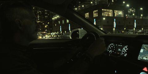 Motor vehicle, Automotive mirror, Automotive design, Night, Darkness, Steering wheel, Steering part, Glass, Light, Automotive lighting,