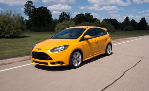 Land vehicle, Vehicle, Car, Automotive design, Yellow, Rim, Mid-size car, Hatchback, Ford, Automotive tire,