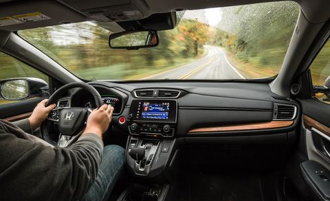 Automotive mirror, Mode of transport, Steering part, Automotive design, Steering wheel, Vehicle, Glass, Car, Radio, Electronic device,