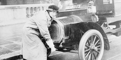 woman hand cranking car