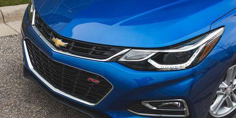 Motor vehicle, Blue, Automotive design, Daytime, Vehicle, Grille, Land vehicle, Headlamp, Car, Automotive lighting,