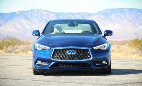 Motor vehicle, Automotive design, Blue, Daytime, Road, Vehicle, Hood, Land vehicle, Automotive mirror, Grille,