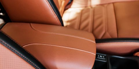 Brown, Textile, Orange, Leather, Tan, Car seat, Peach, Head restraint, Gloss, Car seat cover,