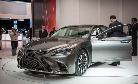 Automotive design, Vehicle, Event, Land vehicle, Car, Personal luxury car, Auto show, Exhibition, Mid-size car, Luxury vehicle,