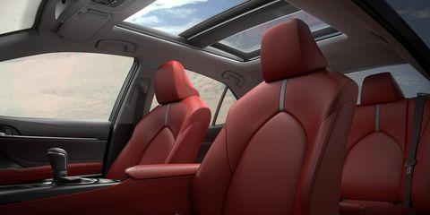 Motor vehicle, Mode of transport, Vehicle, Vehicle door, Car seat, Car seat cover, Head restraint, Carmine, Steering wheel, Steering part,