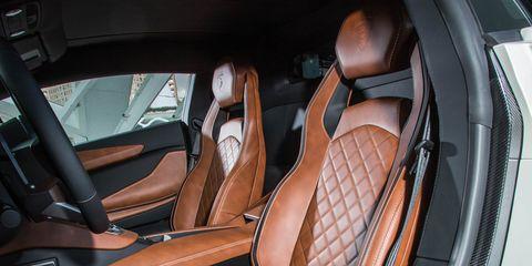 Car seat cover, Vehicle, Car, Car seat, Seat belt, Vehicle door, Personal luxury car, Automotive design, Luxury vehicle, Steering wheel,