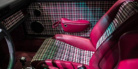 Magenta, Classic car, Steering wheel, Steering part, Coffee cup, Serveware, Cup, Kitchen utensil, Armrest, Car seat,