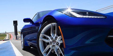 Tire, Automotive design, Blue, Alloy wheel, Vehicle, Rim, Automotive tire, Automotive wheel system, Automotive exterior, Car,