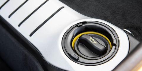 Yellow, Automotive design, Lens, Carbon, Grey, Close-up, Cameras & optics, Gadget, Trademark, Camera lens,