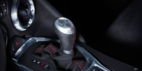 Automotive design, Personal luxury car, Steering part, Luxury vehicle, Steering wheel, Gear shift, Center console, Carbon, Sports car, City car,