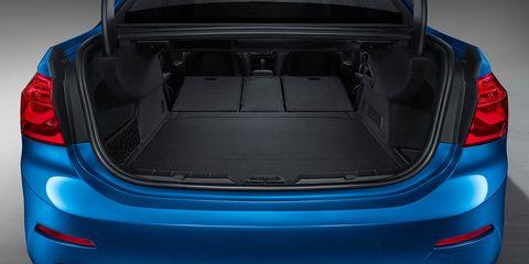 Automotive design, Blue, Vehicle, Trunk, Car, Automotive exterior, Automotive tail & brake light, Bumper, Hatchback, City car,